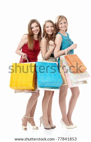 Attractive girls with bags on a white background
