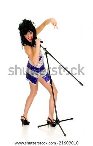 Attractive glitter dressed music performer, singer songwriter.  Studio, white background