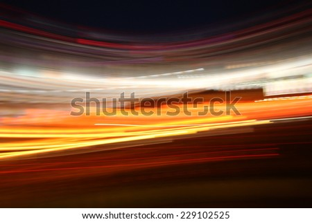 Attractive Glowing Colored Abstract Neon Lights in Motion for Wallpaper Background. - stock photo