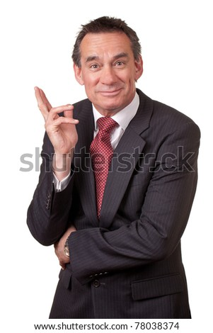Attractive Grinning Middle Age Business Man in Suit on the verge Laughing - stock photo
