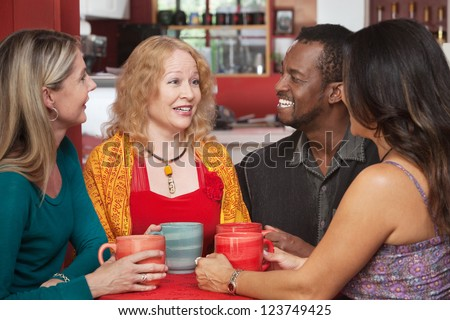 Attractive group of adults sitting together in a restaurant