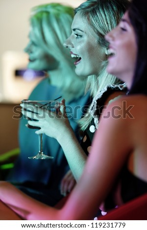 Attractive group of friends laughing and having fun in a nightclub - stock photo