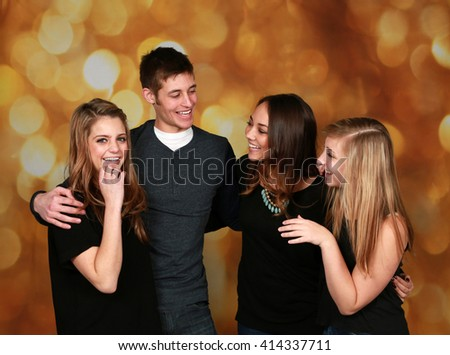 attractive group of older teen friends laughing  - stock photo