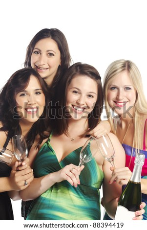 Attractive group of young happy girls with champagne isolated over white background