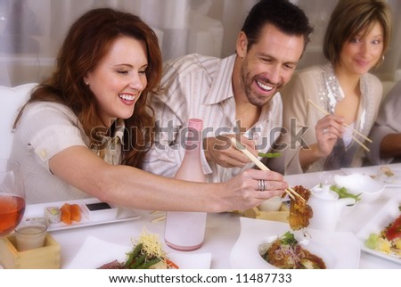 Attractive group of young professionals, this edit has slight blur on edges in order to emphasize the couple. - stock photo