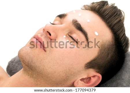 Attractive guy in spa salon - stock photo