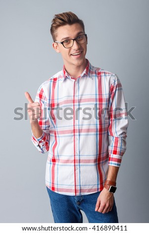 Attractive guy is showing ok sign - stock photo