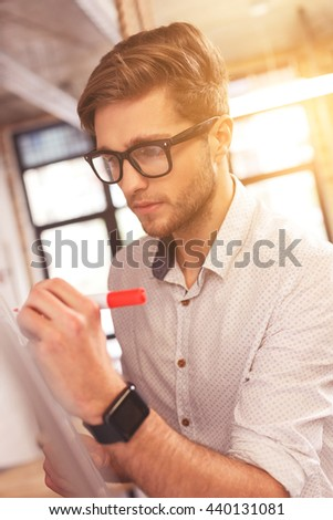 Attractive guy is thinking about project - stock photo