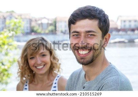 Attractive guy with beard in love with girlfriend