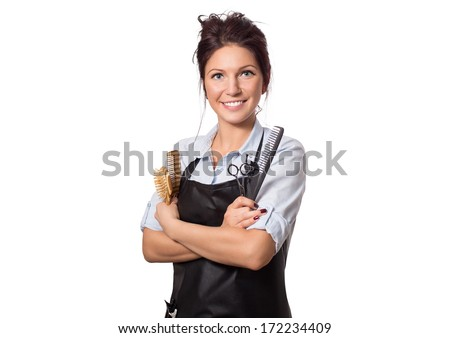 Attractive hairdresser woman with professional tools in her hands. Isolated on white. - stock photo