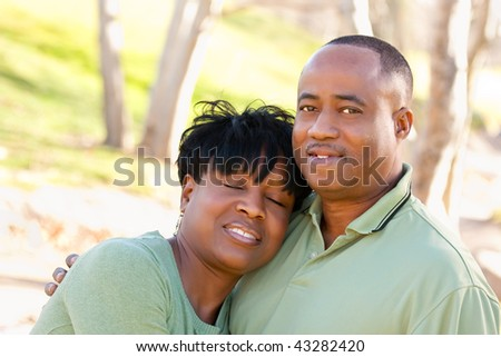 Attractive Happy African American Couple Posing in the Park. - stock photo