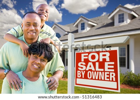 Attractive, Happy African American Family with For Sale By Owner Sign in Front of House. - stock photo