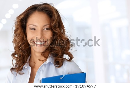Attractive happy businesswoman smiling, copyspace on left. - stock photo