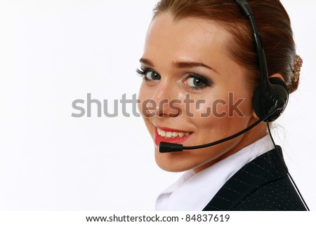 Attractive happy businesswoman with headset isolated on white - stock photo