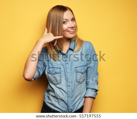 attractive happy girl  gesturing with fingers call me