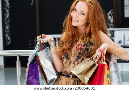 Attractive happy girl out shopping - stock photo