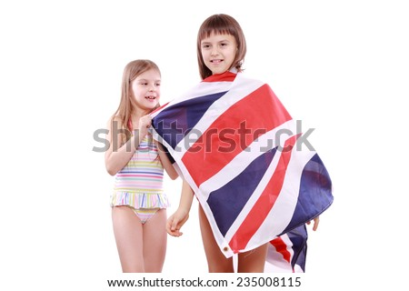 Attractive happy kids with Great Britain flag on summer vacation on Holiday theme - stock photo