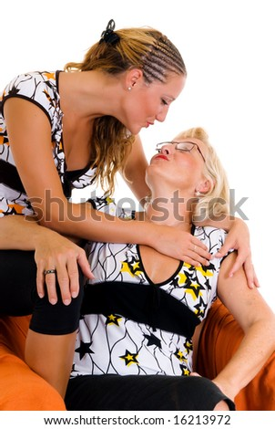 Attractive happy mother and daughter interacting in sofa.
