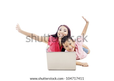 Attractive happy mother with her son smiling and posing with laptop computer