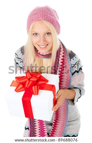 attractive happy smile young girl, hold gift box with red bow, wear winter knitted pink hat scarf and sweater, isolated over white background, looking up at camera, top angle view - stock photo