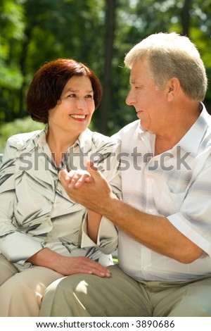 Attractive happy smiling successful senior couple embracing outdoors - stock photo