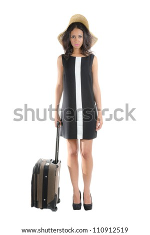 Attractive happy traveler  woman with suitcase. Isolated on white.