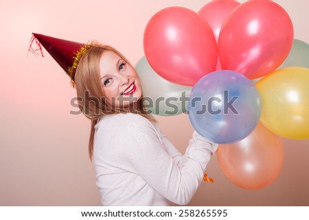 Attractive Happy Young Woman with Birthday Balloons - stock photo