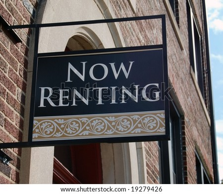 Attractive high end For Rent Now Renting sign with scroll design on brick building for a house or apartment property for rental or lease for  temporary residence - stock photo
