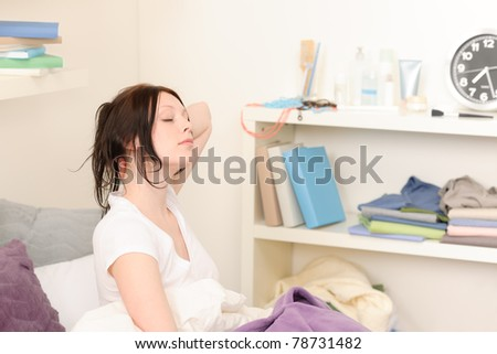 Attractive high-school girl wake up in student apartment
