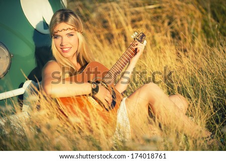 attractive hippie girl with guitar - stock photo