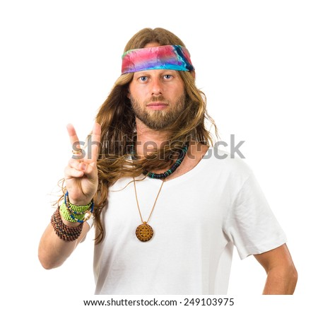 Attractive hippie giving a peace sign isolated on white - stock photo