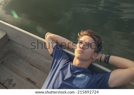 Attractive Hipster Male Relaxing Near River