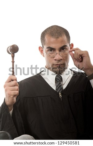 Attractive hispanic african american judge holding gavel - stock photo