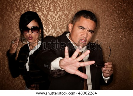 Attractive Hispanic couple caught in a paparazzi photographer flash - stock photo