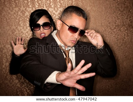 Attractive Hispanic couple caught in photographer flash - stock photo