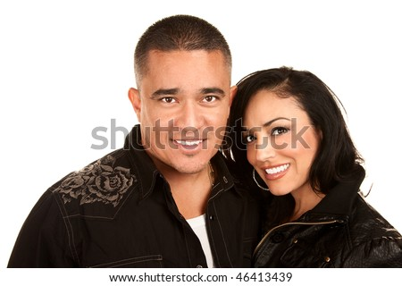 Attractive Hispanic couple in casual clothes on white background - stock photo