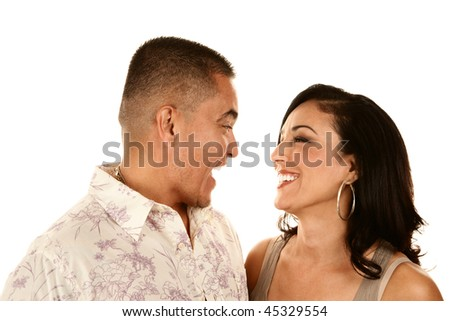 Attractive Hispanic Couple on White Background Laughing - stock photo