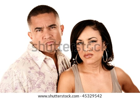 Attractive Hispanic Couple on White Background Showing Disgust or Anger