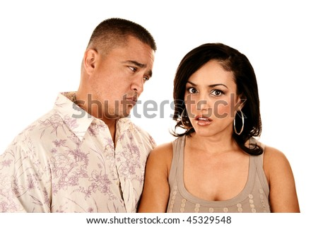 Attractive Hispanic Couple on White Background Showing Skepticism or Anger - stock photo