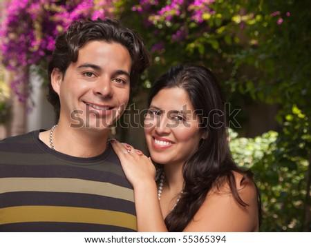 Attractive Hispanic Couple Portrait Enjoying Each Other Outdoors. - stock photo