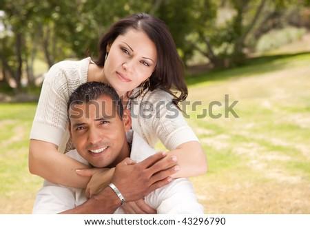 Attractive Hispanic Couple Portrait in the Park. - stock photo