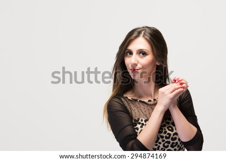 Attractive hispanic latino lady elegantly looking at the camera in front of white background - stock photo