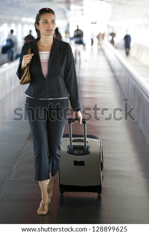 attractive hispanic woman going on holidays - stock photo