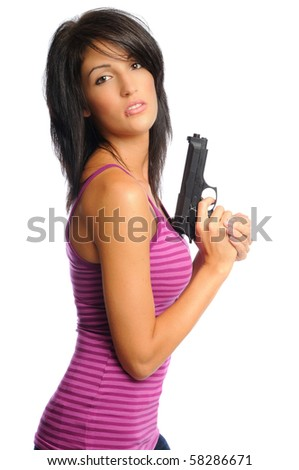 attractive hispanic woman holding a gun on a white background - stock photo