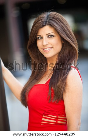 Attractive hispanic woman in her forties - stock photo
