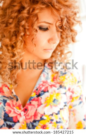 attractive hot young curly redhead woman smiling