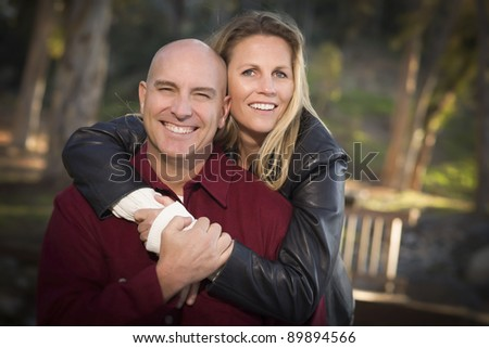 Attractive Hugging Young Couple Portrait in the Park. - stock photo