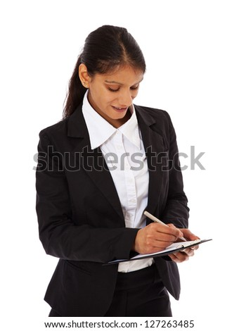 Attractive indian businesswoman taking notes. All on white background.