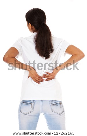 Attractive indian girl suffers from backache. All on white background. - stock photo