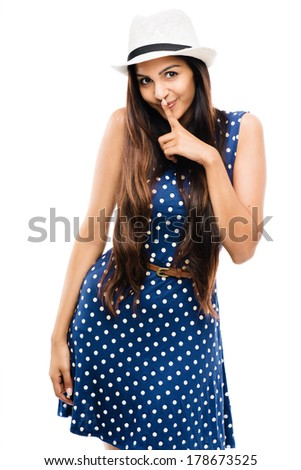 attractive Indian woman finger on lips - stock photo